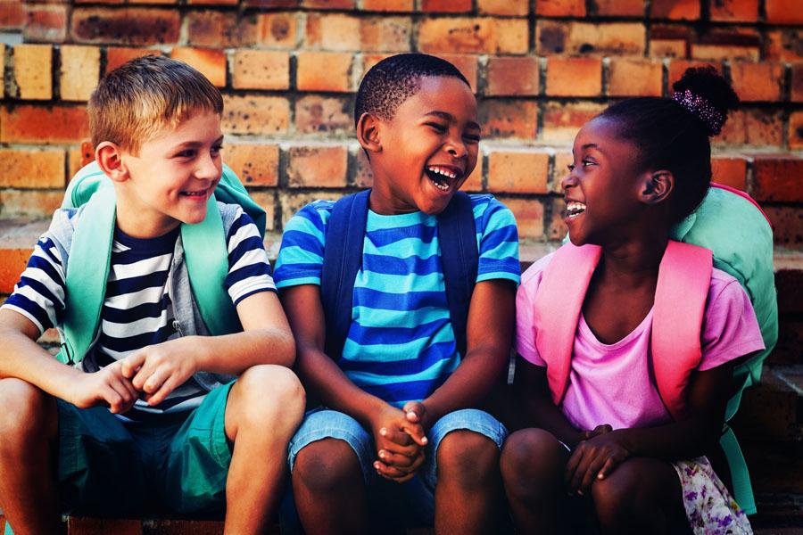 School Insurance - School Age Children Talking Together Outside School