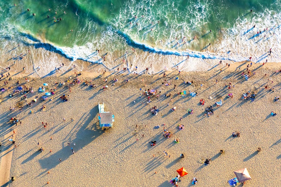 Corona, CA Insurance - Overhead View of the Pacific Ocean Teal Waters on a Sunny Day