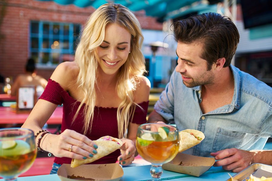 Specialized Business Insurance - Young Couple Out to Eat at a Mexican Restaurant